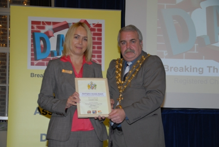 Photo of Carmel College representative receiving Award from the Mayor